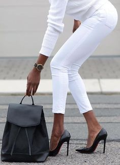all white + black heels and bag.