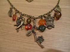 MCU004 VINTAGE STYLE OWL NECKLACE ~ MandycraftsUK    Vintage style antique bronze necklace with chain and several charms attached including two leaves, a pair of love birds, a flowery tree branch, an owl and coloured acrylic beads in shades of orange, green and brown. Chain is 56cm long and branch charm is 4cm long.     PRICE: £15.00 + £ 1.50 postage (UK only)   PAYMENT: Paypal only   CONTACT DETAILS:   Business Name/Facebook Page: https://www.facebook.com/MandycraftsUK