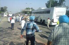 AAP activist led by MP Harinder Singh Khalsa attempt to stop Indo-Canadian Bus, burn effigy of Badal Govt. - http://sikhsiyasat.net/2015/05/04/aap-activist-led-by-mp-harinder-singh-khalsa-attempt-to-stop-indo-canadian-bus-burn-effigy-of-badal-govt/