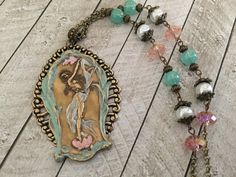 A personal favorite from my Etsy shop https://www.etsy.com/listing/265125118/woodland-nymph-dancing-fairy-necklace