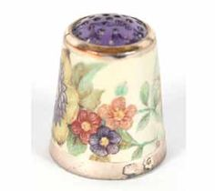 Delicately painted thimble.