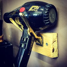 Barbershop interior design hairdryer holder made from hand clippers
