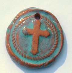 Round Pottery Ceramic Cross Pendant in Terracotta and Turquoise Charm Religious Pendant by Clay Designs by glee Jewelry Components by ClayDesignsbyglee on Etsy https://www.etsy.com/listing/209058812/round-pottery-ceramic-cross-pendant-in
