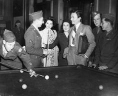 London, 1944: English actor James Mason (3rd from right) talks to GIs playing snooker in the games room of the Rainbow Corner Club at Piccadilly, London. (Photo by Keystone/Getty Images)