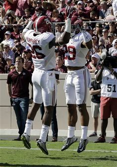 Alabama 's Minkah Fitzpatrick (29) celebrates with teammate Marlon Humphrey (26) after he made an interception and scored a touchdown against Texas A&M during the first half of an NCAA college football game, Saturday, Oct. 17, 2015, in College Station, Texas.