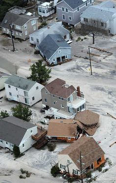 Homes in Beach Haven on the southern end of Long Beach Island, N.J. are severely damaged after superstorm Sandy moved through the area Tuesday, Oct. 30, 2012. (AP Photo/The Philadelphia Inquirer, Clem Murray)