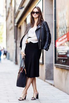 A black midi skirt with a leather jacket is a great combo for an office look. // #StyleTips