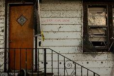 A hand-written note to rescue workers is seen on a house that was damaged by a tornado. (AP Photo/Tulsa World, Adam Wisneski) Joplin Tornado May 22, 2011