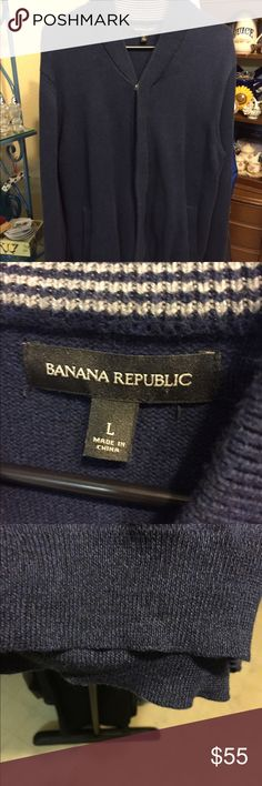 Banana Republic zip down sweater NWOT'S, nice navy blue color , no fading or stretch. Had pockets and snaps in two places and zips in front. Very nice thick sweater! Banana Republic Sweaters Zip Up