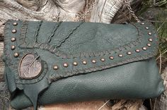 Leather clutch made from beautiful forest green deer hide, antiqued copper spots, chain strap, and hand made copper aspen leaf focal piece