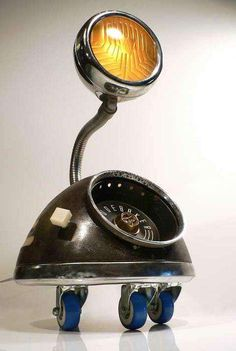 """John Stephenson has been making lighting sculptures since the 1980's. He likes to reconstruct fixtures from various car parts from the 1930's-1960's to make retro forms representing the """"future."""""""