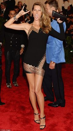 Love the heels! Peace out: Supermodel Gisele Bundchen created her own punk fashion moment in Anthony Vaccarello
