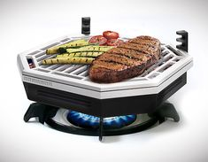 "Element Indoor Smokeless BBQ | What if you could ""grill"" a steak right on your stovetop? No going outside, no firing up the grill or waiting for the charcoal to start glowing … Surprise, you can. This stovetop grilling unit fits right over your stove's burner using gas or electric power to heat up its lava rocks for smoke-free indoor grilling. Simple, adjustable, mess-free design means more meat with less effort. ♥  #kitchen #cooking #Baking #gadgets #tools #Appliances #grill"