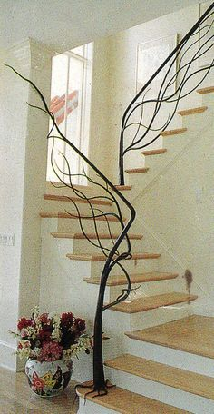 I love this custom made natural tree staircase. Staircase railing is usually just.staircase railing, but this railing is different and unique! This is great for a rustic, country, and even modern decor look. Balustrades, Banisters, Staircase Railings, Staircase Design, Hand Railing, Modern Staircase, Wrought Iron Stair Railing, Wrought Iron Decor, Stairs Without Railing