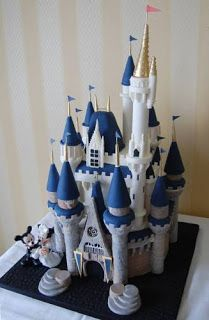 Cinderella Castle Wedding Cake in blues and whites with Mickey and Mini Mouse cake topper placed at the base of the cake. Great for Disney enthusiasts.