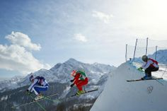 DAY 14:  (L-R) Egor Korotkov of Russia, Armin Niederer of Switzerland and Filip Flisar of Slovenia compete during the Freestyle Skiing Men's Ski Cross http://sports.yahoo.com/olympics