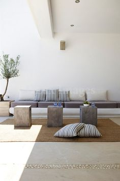 concrete cube tables + floor pillows-outdoor area-bring pillows in when we aren't there