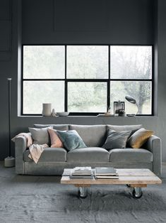 Moody shades | Grey velvet sofa with pink and blue velvet cushions | Scandinavian minimalism | industrial style window | IKEA Vimle sofa with a Bemz cover in Zinc Grey Malmen velvet | styled by Pella Hedeby