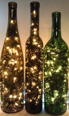 Rustic wedding decor idea, add fairly lights inside vintage glass wine bottles!