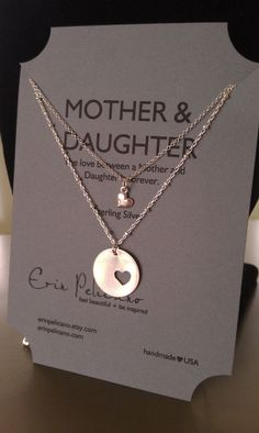 perfect gift for me and gracie may...Mother & daughter necklaces. love this