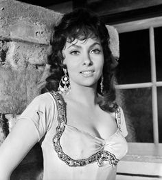 Gina Lollobrigida (with Anthony Quinn), as the seductive gypsy Esmeralda, in The Hunchback of Notre Dame, 1956