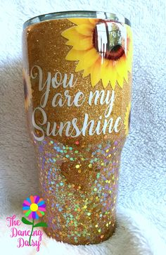 30 oz tumbler - You are my Sunshine; Sunflower gold tumbler 30 oz tumbler You are my Sunshine Sunflower gold tumbler Diy Tumblers, Personalized Tumblers, Custom Tumblers, Glitter Tumblers, Tumblr Cup, Dancing Daisy, Cup Crafts, Nifty Crafts, Resin Crafts