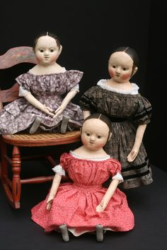 A family portrait... The doll in the pink dress has been sold.