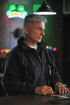 """Bar Work - Season 10, #10.      Gibbs (Mark Harmon) and the NCIS team is """"following the money"""" in order to solve a murder investigation, and Abby is bursting with excitement over all the holiday festivities. Photo: Sonja Flemming/CBS ©2012 CBS Broadcasting, Inc. All Rights Reserved."""