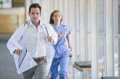 image #009bwq15 Doctor and nurse running down hospital corridor #photo #image #urgence #hopital #medecin #couloir
