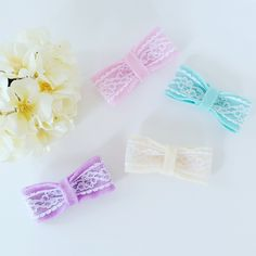 This set comes with four felt bows lined with a lace detail. Colors are- Pink, Blue, Ivory and Purple.These can be placed on clips or headbands. Please leave choice in notes section at chec...