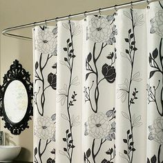 The Cassandra shower curtain features a crisp black-and-white Asian-inspired floral that will go with everything, and add a touch of elegance to your bathroom.