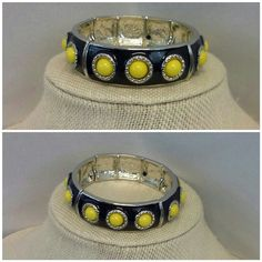 "Navy and Yellow Enamel with Silver-tone Bracelet Navy and Yellow Enamel with Silver-tone Bracelet, four section, stretchy, 5/8"" wide, New With Tag, in bubble wrap and plastic,  49% off of new retail $25. ADD TO A BUNDLE! Jewelry Bracelets"