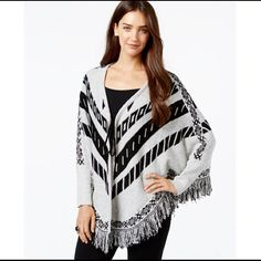 NY Print Tie-front Poncho Sweater It's brand new without tag. Color is black innocence. Poncho style sleeves and Fringe trim evoke southwest chic. Collarless. Tie closure at front. Long poncho sleeve and fitted cuffs. All over geometric intarsia print. Easy fit. Hits at low hip. Fringe trim at v-hem. 90% acrylic and 10% polyester. Size Large (12-14) (60) NY Collection Sweaters Shrugs & Ponchos