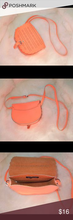 American Eagle Neon Orange Crossbody American Eagle Neon orange Crossbody. Used but in great condition. Super clean inside and out. Light and super cute to carry your essentials.  Feel free to make an offer via offer button only.  •No Trades•  Interested in free shipping? Check out my Instagram for more info: @JackLagPosh American Eagle Outfitters Bags Crossbody Bags