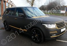 Range Rover Vogue fully wrapped in a matt black vinyl car wrap with mirror gold vinyl detailing | by Totally Dynamic