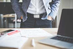 Free Image: Businessman Standing in his Office | Download more on picjumbo.com!