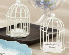 Lovely birdcage candle holders or place card holders as low as $3.83.  Perfect for a love bird wedding theme.