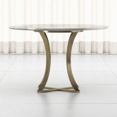 """Shop Damen 48"""" White Marble Top Dining Table. Sophisticated materials engage in modern geometry to shape this elegant dining table. Brass-finished iron curves the open pedestal base that supports a round top of polished white marble. Cb2 Dining Table, Table Seating, Dining Chairs, Cb2 Furniture, Unique Furniture, Marble Top Dining Table, Classic Dining Room, Art Deco, Elegant Dining"""