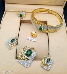 Checkout this latest Jewellery Set Product Name: *Elite Chunky Jewellery Sets* Base Metal: Brass Plating: Gold Plated Stone Type: Cubic Zirconia/American Diamond Type: Pendant and Earrings Multipack: 1 Country of Origin: India Easy Returns Available In Case Of Any Issue   Catalog Rating: ★4 (222)  Catalog Name: Twinkling Glittering Jewellery Sets CatalogID_2274619 C77-SC1093 Code: 562-11956125-216