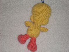 Tweety Bird  Materials  Yellow and orange yarn  white, blue and orange felt  H hook  fiber fill  needle and thread