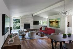 Laura Roberts Design.  Hugh Jefferson Randolph Architects.  Photo by Whit Preston.  Modern living room; shiplap; silver travertine; Cumaru; Poltrona Frau; McGuire; B & B Italia; red sofa, fine art, Austin design.