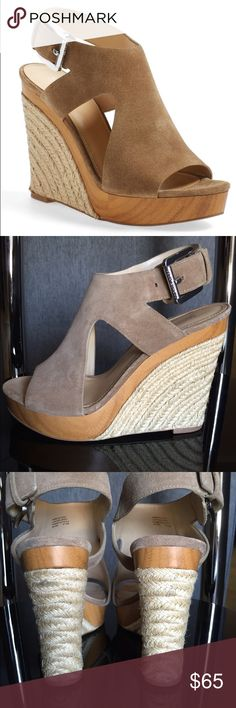 Michael Kors Wedges True to size. A wood-look platform refreshes a single panel sandal set atop a stack wedge. MICHAEL Michael Kors Shoes Wedges