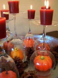 """Luxury on a Budget""  Fall Tablescape using pinecones,resin mini pumpkins, wine glasses, & candles from Dollar Tree"