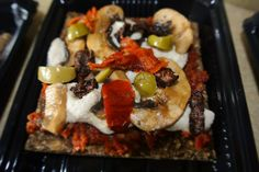Raw pizza made on the Pura Vida sprouted raw onion bread base with cashew 'cheese', mushrooms, olives and sun-dried tomatoes!