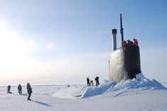 In this March 19, 2011 photo released by the U.S. Navy, crew members look out from the USS Connecticut, a Sea Wolf-class nuclear submarine, after it surfaced through ice in the Arctic Ocean.