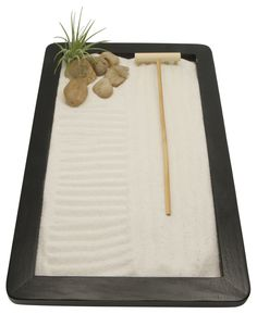 Meditation Zen garden complete with white sand, smooth rocks and an airplant. Zen gardens and meditation supplies available at BuddhaGroove.com. #zengardens