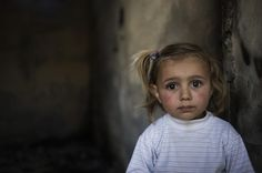 A small girl of 3. She could be dying. She could be crying. Found on UNICEF.
