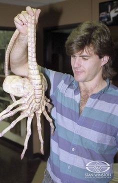 "Special Effects Character Creator Alec Gillis shows off the Stan Winston Studio ""facehugger"" puppet from ALIENS."