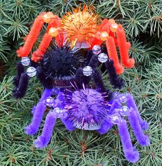 Happier Than A Pig In Mud: Bottle Cap Spiders for Halloween-Tutorial~T~ So much fun for the kids to make. Use water bottle caps, Pom-Poms, Chenille stems, goggly eyes, beads, string or fishing line for hanging and quick drying glue or hot glue gun.