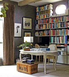 Cozy room with antique white table and white bookshelves